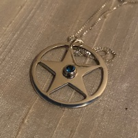 Pentagram pendant with blue Topaz